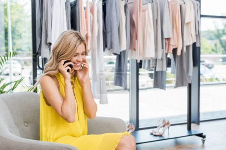 Woman talking by phone in showroom