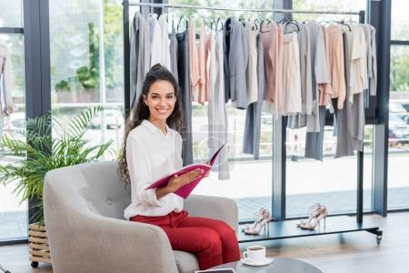 woman reading magazine in showroom