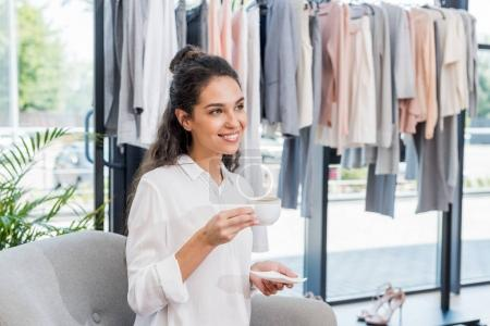 woman drinking coffee in showroom