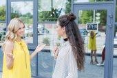 Women talking outdoors