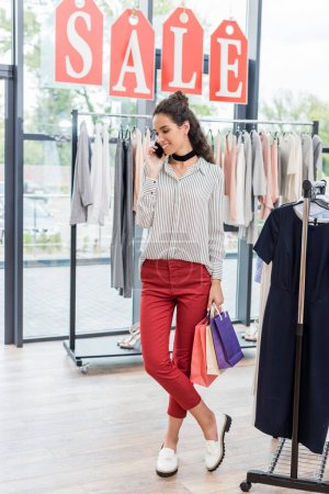 Woman in clothes store
