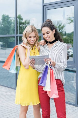 Women on shopping looking at tablet