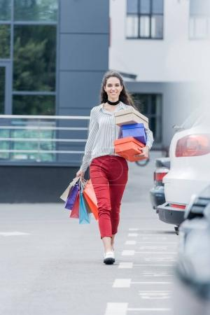 woman with shopping bags and boxes