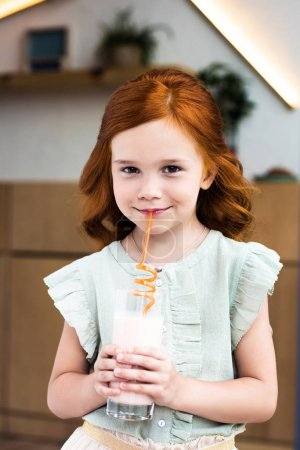 girl drinking milkshake in cafe