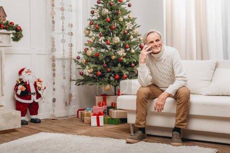 Man talking on smartphone on christmas
