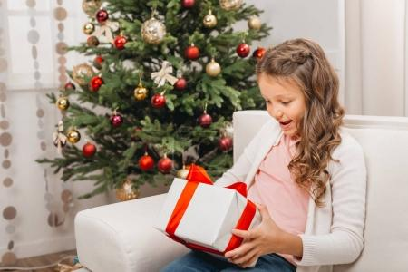 little child with christmas gift