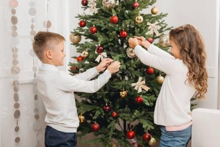 Kids decorating christmas tree