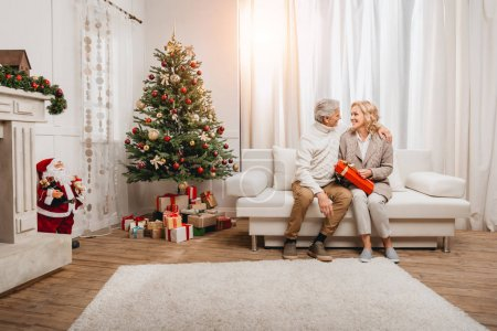 man and woman with christmas gift