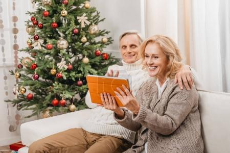Couple making video call on christmas