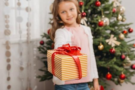 child with christmas gift