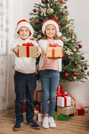 adorable kids with gift boxes