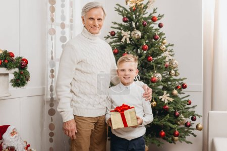grandfather and grandson with christmas gift