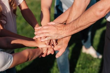 Photo for Partial view of family holding hands together - Royalty Free Image