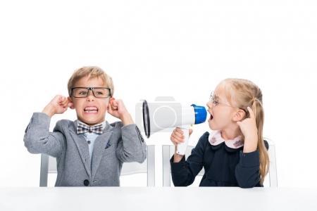 schoolgirl shouting on boy with loudspeaker