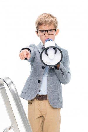 schoolboy on stepledder with loudspeaker