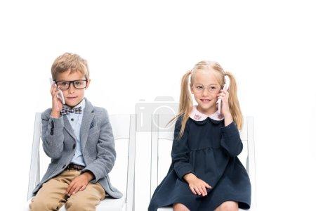 adorable kids with smartphones