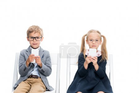 adorable kids with smartphones