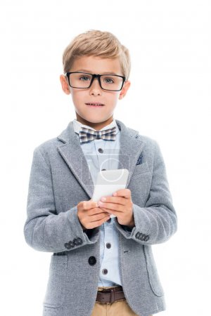 Focused schoolboy using smartphone