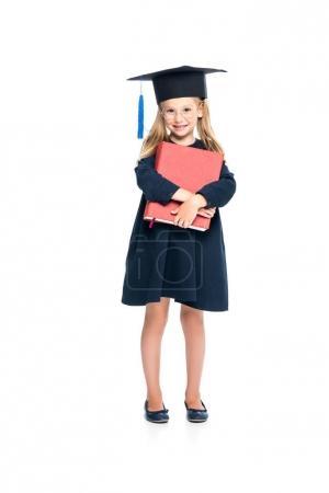 schoolgirl in graduation hat with big book