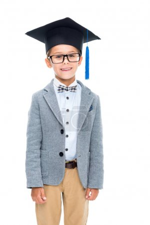 Happy schoolboy in graduation hat