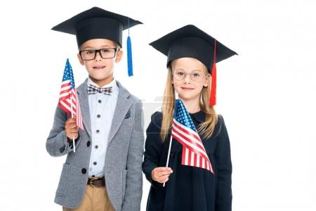 pupils in graduation hats with usa flags