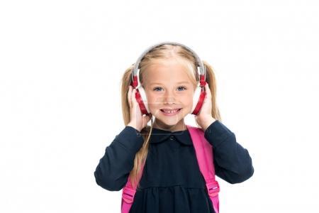 Photo pour Belle écolière avec casque sans fil isolé sur blanc - image libre de droit