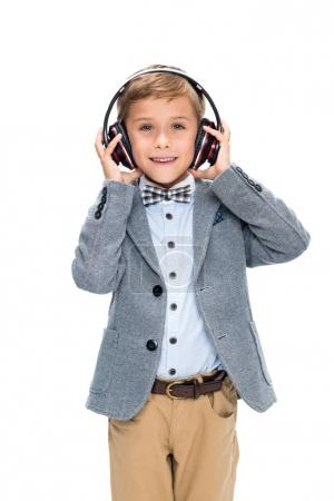 Photo for Schoolboy in wireless headphones isolated on white - Royalty Free Image