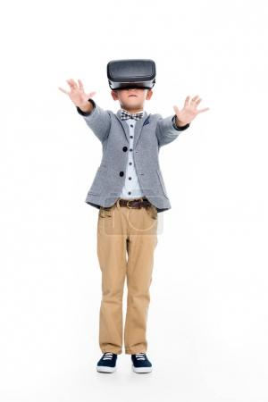 schoolboy in VR headset with outstretched hands