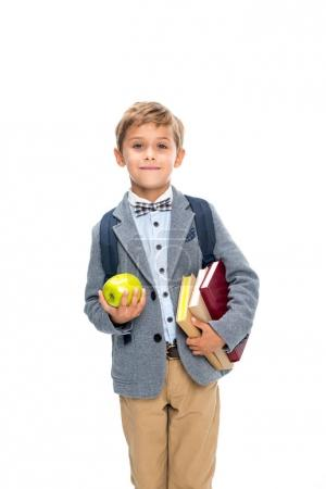 schoolboy with books and apple