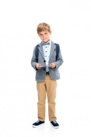 smiling schoolboy with digital tablet