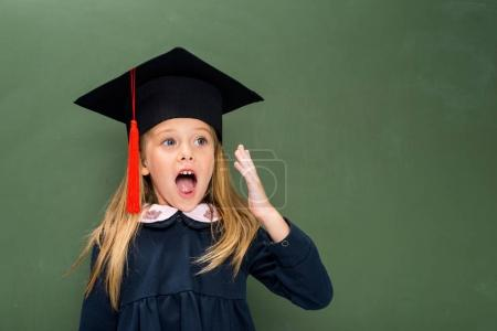 shouting schoolgirl in graduation hat
