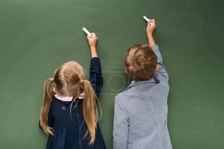 Pupils writing on chalkboard