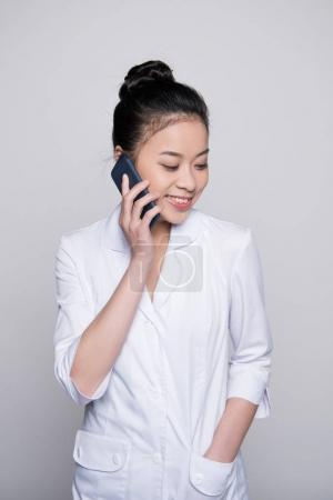 Smiling nurse talking on phone