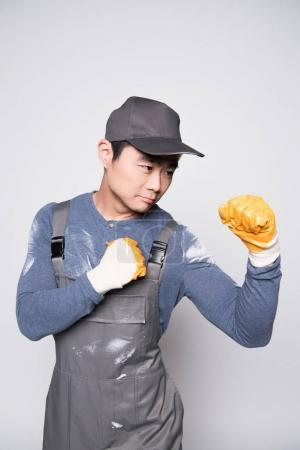 Construction worker in fighting pose