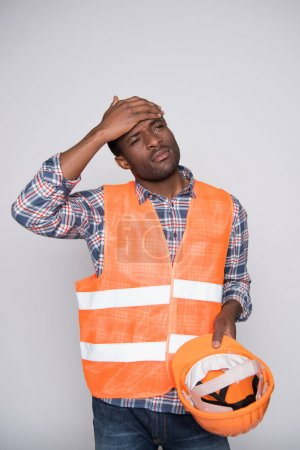 construction worker wiping sweat