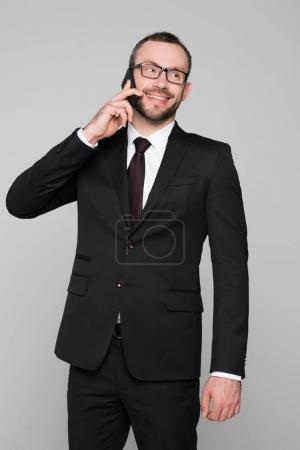 smiling young businessman talking on phone