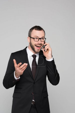 Cheerful young businessman talking on phone