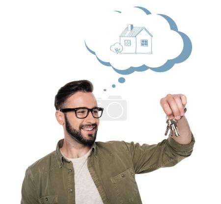 Photo for Portrait of caucasian smiling man holding keys thinking about house - Royalty Free Image