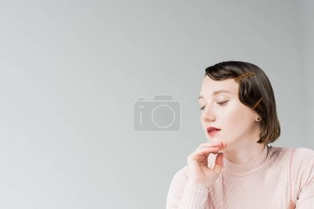 pensive woman with retro hairstyle