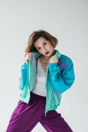 Photo for Fashion portrait of attractive young girl in vintage windcheater suit - Royalty Free Image