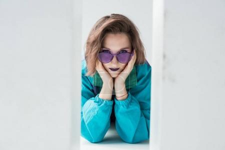 girl in windcheater jacket and purple sunglasses