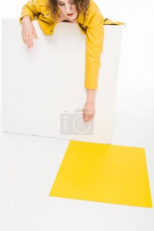 Photo for Fashion portrait of young girl in all yellow laying in white cube - Royalty Free Image