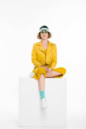 Photo for Fashion portrait of young girl in all yellow and vintage plastic cap isolated on white - Royalty Free Image