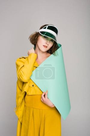 Photo for Fashion portrait of cute young girl in retro plastic cap and yellow leather jacket - Royalty Free Image