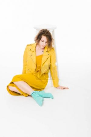Trendy girl in yellow clothes
