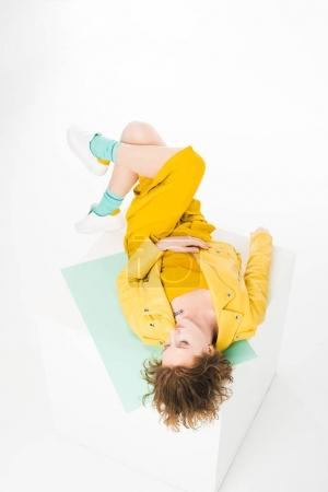 Photo for Attractive stylish girl lying in yellow clothes - Royalty Free Image