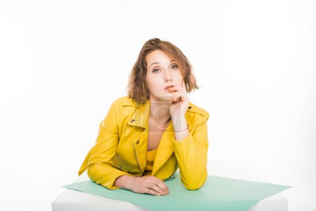 Photo for Beautiful stylish pensive girl posing in yellow leather jacket - Royalty Free Image
