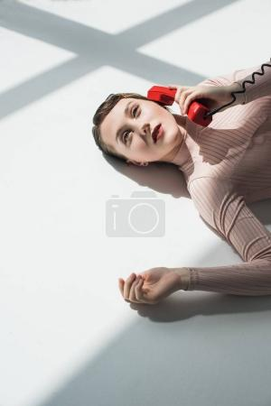 girl with vintage phone tube