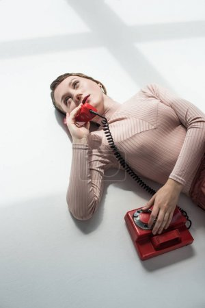 girl with vintage rotary telephone