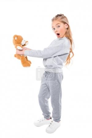 surprised child with teddy bear